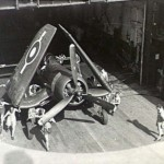 corsair_being_pushed_on_elevator_hms_glory_r62_1945